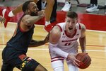 Wisconsin's Micah Potter tries to get past Maryland's Galin Smith during the second half of an NCAA college basketball game Monday, Dec. 28, 2020, in Madison, Wis. (AP Photo/Morry Gash)