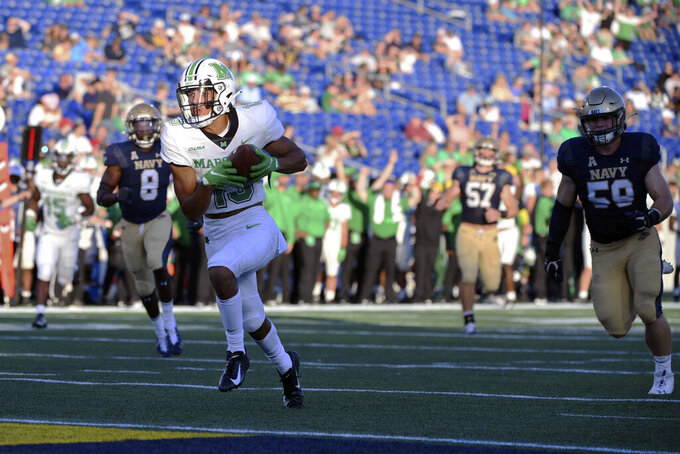 Marshall wide receiver EJ Horton (13) scores a touchdown on pass from Marshall quarterback Luke Zban during the second half of an NCAA college football game against Navy, Saturday, Sept. 4, 2021, in Annapolis, Md. (AP Photo/Terrance Williams)
