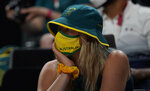 An Australian fan reacts after their loss in the men's basketball semifinal game between the United States and Australia at the 2020 Summer Olympics, Thursday, Aug. 5, 2021, in Saitama, Japan. (AP Photo/Eric Gay)