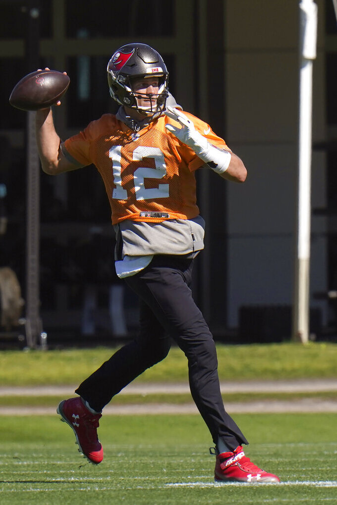 Tampa Bay Buccaneers quarterback Tom Brady (12) throws a pass during a workout Thursday, Jan. 28, 2021, in Tampa, Fla. The Buccaneers play the Kansas City Chiefs in NFL football Super Bowl LV on Feb. 7. (AP Photo/Chris O'Meara)