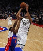 Milwaukee Bucks forward Giannis Antetokounmpo (34) shoots as Detroit Pistons guard Langston Galloway (9) defends during the second half of Game 4 of a first-round NBA basketball playoff series, Monday, April 22, 2019, in Detroit. (AP Photo/Carlos Osorio)
