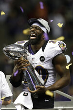 FILE - In this Feb. 3, 2013, file photo, Baltimore Ravens free safety Ed Reed (20) holds the Vince Lombardi Trophy after the Ravens defeated the San Francisco 49ers in the NFL Super Bowl XLVII football game in New Orleans. Reed will be inducted into the Pro Football Hall of Fame in Canton, Ohio, on Aug. 3, 2019. (AP Photo/Elaine Thompson, File)