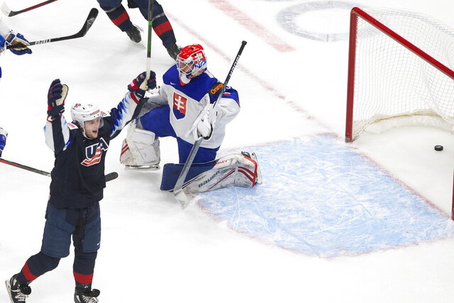 United States' John Farinacci (25) celebrates his goal on Slovakia goalie Simon Latkoczy (30) during the second period of an IIHL World Junior Hockey Championship game, Saturday, Jan. 2, 2021 in Edmonton, Alberta. (Jason Franson/The Canadian Press via AP)
