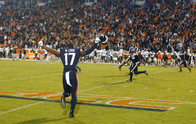 Virginia linebacker Malcolm Cook (17) celebrates during the second half of an NCAA college football game in Charlottesville, Va., Saturday, Oct. 13, 2018. Virginia defeated Miami 16-13. (AP Photo/Steve Helber)