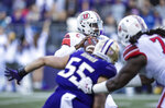Utah quarterback Tyler Huntley drops back to pass under pressure during the first half of an NCAA college football game against Washington, Saturday, Nov. 2, 2019, in Seattle. (AP Photo/Stephen Brashear)