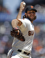 San Francisco Giants pitcher Madison Bumgarner works against the Arizona Diamondbacks in the first inning of a baseball game Sunday, June 30, 2019, in San Francisco. (AP Photo/Ben Margot)