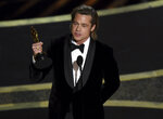 Brad Pitt accepts the award for best performance by an actor in a supporting role for