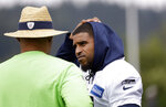 Seattle Seahawks' Bobby Wagner, right, talks with defensive coordinator Ken Norton Jr. during an NFL football practice Tuesday, May 21, 2019, in Renton, Wash. (AP Photo/Elaine Thompson)
