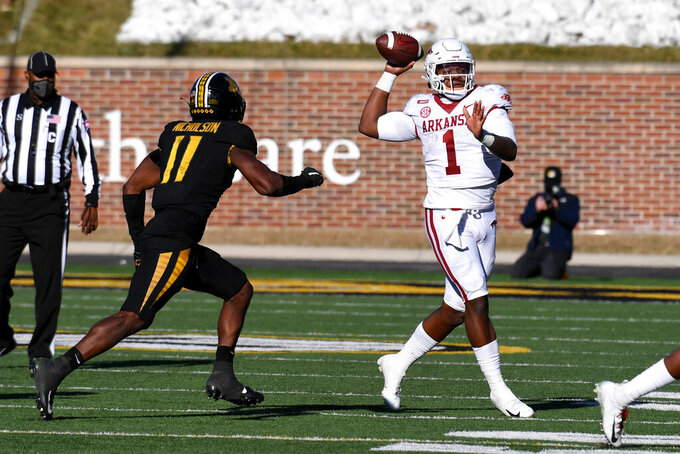 Arkansas quarterback KJ Jefferson (1) throws as Missouri linebacker Devin Nicholson defends during the second half of an NCAA college football game Saturday, Dec. 5, 2020, in Columbia, Mo. (AP Photo/L.G. Patterson)