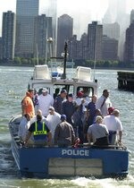 FILE- In this Sept. 15, 2001, file photo, members of the New York Giants ride  a police boat across the Hudson River Jersey City, N.J to New York, to delivery supplies and get a look at the devastation from the terrorist attacks on Sept. 11. A backup quarterback and holder for the Giants in 2001, New York Giants offensive coordinator Jason Garrett spoke Thursday, Sept. 9, 2021, about the Sept. 11 attacks and the tragedy that claimed almost 3,000 lives that day.  (AP Photo/Daniel Hulshizer, File)