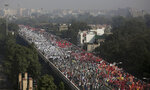FILE - In this Friday, Nov. 30, 2018 file photo, Indian farmers and agricultural laborers march towards the Indian Parliament during a protest rally in New Delhi, India. India's slowing economy appears not to have deterred millions of voters from supporting Prime Minister Narendra Modi and his Hindu nationalist party's return to power. Final curtain fell down on Friday, May 24, 2019, on the marathon Indian parliament election that gave a second term for Prime Minister Narendra Modi, despite his government's flawed economic performance and his Hindu nationalist party's divisive rhetoric. (AP Photo/Altaf Qadri)