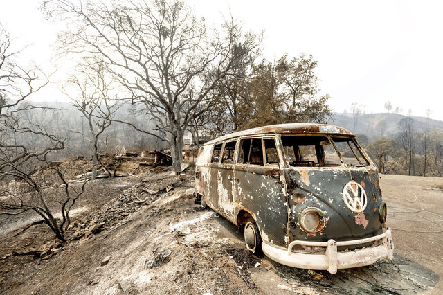 Following the LNU Lightning Complex fires, a scorched VW Microbus rests in a driveway of the Spanish Flat community in Napa County, Calif., on Monday, Aug. 24, 2020. (AP Photo/Noah Berger)