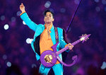 FILE - In this Feb. 4, 2007, file photo, Prince performs during the halftime show at the Super Bowl XLI football game in Miami. The music icon died of an accidental opioid overdose at his Paisley Park studio on April 21, 2016. (AP Photo/Chris O'Meara, File)
