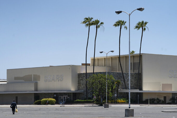 This Thursday, May 27, 2021, photo shows the closed Sears in Buena Park Mall in Buena Park, Calif. California state lawmakers are grappling with a particularly 21st-century problem: What to do with the growing number of shopping malls and big-box retail stores left empty by consumers shifting their purchases to the web. A possible answer in crowded California cities is to build housing on these sites, which already have ample parking and are close to existing neighborhoods. (AP Photo/Damian Dovarganes)