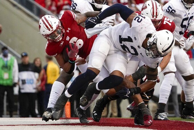 Wisconsin's Chez Mellusi runs for a touchdown during the second half of an NCAA college football game against Penn State Saturday, Sept. 4, 2021, in Madison, Wis. Penn State won 16-10. (AP Photo/Morry Gash)