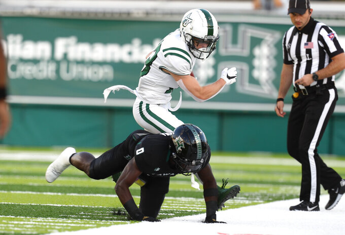 Portland State wide receiver Beau Kelly (13) is tackled on the sideline by Hawaii defensive back Chima Azunna (0) after making a catch during the first half of an NCAA college football game, Saturday, Sept. 4, 2021, in Honolulu. (AP Photo/Darryl Oumi)