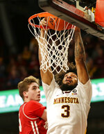 Minnesota forward Jordan Murphy (3) dunks in front of Wisconsin forward Nate Reuvers during the first half of an NCAA college basketball game Wednesday, Feb. 6, 2019, in Minneapolis. (AP Photo/Andy Clayton-King)
