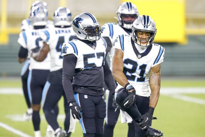 Carolina Panthers' Jeremy Chinn (21) warms up with teaqmmates before an NFL football game against the Green Bay Packers Saturday, Dec. 19, 2020, in Green Bay, Wis. (AP Photo/Matt Ludtke)
