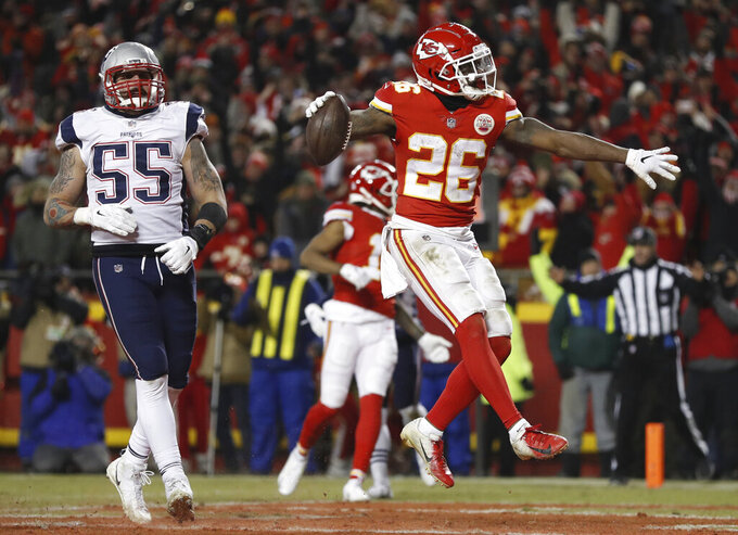 Kansas City Chiefs running back Damien Williams (26) celebrates a touchdown during the second half of the AFC Championship NFL football game against the New England Patriots, Sunday, Jan. 20, 2019, in Kansas City, Mo. (AP Photo/Jeff Roberson)