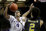 Kansas State's David Sloan (4) shoots under pressure from Alabama State's Kevin Holston (2) during the second half of an NCAA college basketball game Wednesday, Dec. 11, 2019, in Manhattan, Kan. (AP Photo/Charlie Riedel)
