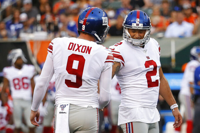 New York Giants kicker Aldrick Rosas (2) celebrates his field goal with holder Riley Dixon (9) during the first half of the team's NFL preseason football game against the Cincinnati Bengals, Thursday, Aug. 22, 2019, in Cincinnati. (AP Photo/Frank Victores)