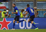 Italy's Giorgio Chiellini, left, celebrates after scoring a goal, which was later disallowed, during the Euro 2020 soccer championship group A match between Italy and Switzerland at Olympic stadium in Rome, Wednesday, June 16, 2021. (Andreas Solaro/Pool Photo via AP)