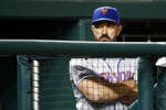 New York Mets manager Mickey Callaway stands in the dugout in the eighth inning of a baseball game against the Washington Nationals, Wednesday, May 15, 2019, in Washington. (AP Photo/Patrick Semansky)
