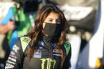 Hailie Deegan walks to her truck before practice for the NASCAR Trucks series auto race at Daytona International Speedway, Thursday, Feb. 11, 2021, in Daytona Beach, Fla. (AP Photo/John Raoux)
