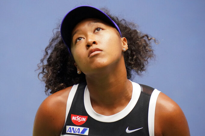 FILE - In this Sept. 12, 2020, file photo, Naomi Osaka, of Japan, reacts during the women's singles final against Victoria Azarenka, of Belarus, during the US Open tennis championships, in New York. Japan is celebrating Naomi Osaka's victory at the U.S. Open, especially her array of corporate sponsors - many of whom represent corporate Japan.But like much of Japan, they are more muted in backing — or understanding —  her campaign against racial injustice in the United States. Unlike the United States, Japan has relatively few immigrants and has a generally low level of awareness about racism — even at home. (AP Photo/Frank Franklin II)