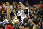 FILE - In this Feb. 3, 2013, file photo, Baltimore Ravens quarterback Joe Flacco is lifted by teammates after defeating the San Francisco 49ers 34-31 in the NFL Super Bowl XLVII football game in New Orleans. Flacco and the Ravens were turning the Super Bowl into a rout when, without even a flicker of warning, the power went off. When the game resumed 34 minutes later, the 49ers were the ones playing lights out. (AP Photo/Bill Haber, File)