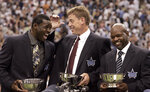 FILE - In this Sept. 19, 2005, file photo, former Dallas Cowboys players, from left, Michael Irvin, Troy Aikman and Emmitt Smith enjoy a moment together after being inducted into the Dallas Cowboys Ring of Honor during halftime of a football game in Irving, Texas. There's plenty of room for debate over the best first-round pick in the history of the Dallas Cowboys. (AP Photo/L.M. Otero, File)