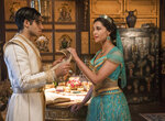This image released by Disney shows Mena Massoud as Aladdin, left, and Naomi Scott as Jasmine in Disney's live-action adaptation of the 1992 animated classic