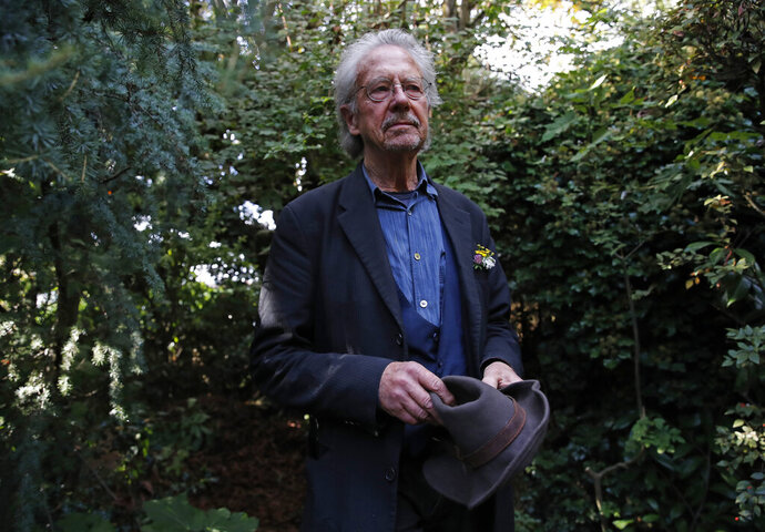 Austrian author Peter Handke poses for a photo in his garden at his house in Chaville near Paris, Thursday, Oct. 10, 2019. Handke was awarded the 2019 Nobel Prize in literature earlier Thursday. (AP Photo/Francois More)