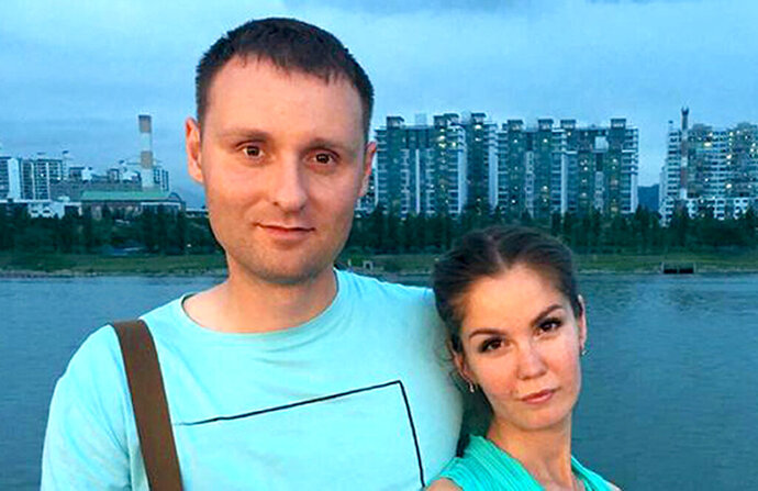 In this undated handout photo released by jw-russia.org, Mikhail Popov and his wife Yelena pose for a photo in Kamchatka region, Far East, Russia. A court in Kamchatka on Friday. Feb. 14, 2020 sentenced Mikhail Popov and his wife Yelena to fines of 350,000 and 300,000 rubles ($5,500 and $4,700) for engaging in extremist activities related to them being Jehovah's Witnesses. Russia officially banned Jehovah's Witnesses in 2017 and declared the group an extremist organization. Crackdown on the group has intensified since then. (jw-russia.org via AP)