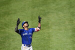 Toronto Blue Jays' Lourdes Gurriel Jr. reacts after hitting his second home run against the Baltimore Orioles, this one in the fifth inning of a baseball game, Sunday, Sept. 12, 2021, in Baltimore. (AP Photo/Gail Burton)