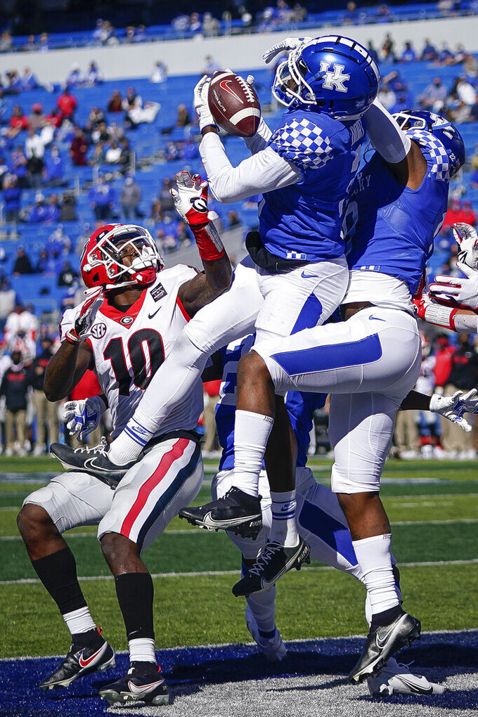Kentucky defensive back Cedrick Dort Jr. (3) breaks up a pass in the end zone during the first half of an NCAA college football game against Georgia, Oct. 31, 2020, in Lexington, Ky. (AP Photo/Bryan Woolston)