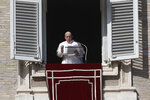 Pope Francis delivers his message during the Angelus noon prayer from the window of his studio overlooking St.Peter's Square, at the Vatican, Sunday, Oct. 25, 2020. (AP Photo/Alessandra Tarantino)