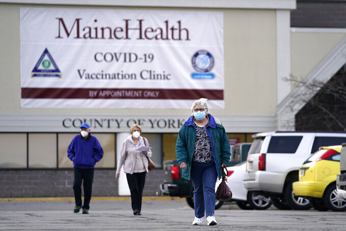 FILE - In this March 3, 2021, file photo, senior citizens leave a COVID-19 vaccination site operated by Maine Health in the site of a former department store in Sanford, Maine. Demand for the coronavirus vaccine has fallen off in some places around the United States to the point where some counties are turning down new shipments of doses. (AP Photo/Robert F. Bukaty, File)