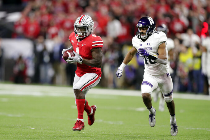 Ohio State wide receiver Johnnie Dixon (1) is chased by Northwestern defensive back Alonzo Mayo (10) during the second half of the Big Ten championship NCAA college football game, Saturday, Dec. 1, 2018, in Indianapolis. (AP Photo/Michael Conroy)