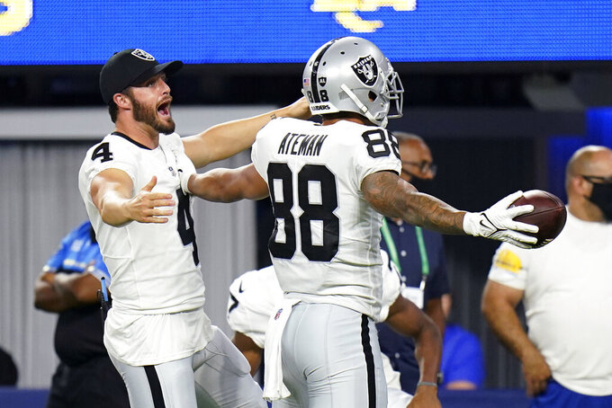 Las Vegas Raiders wide receiver Marcell Ateman (88) celebrates his touchdown catch with Derek Carr (4) during the second half of the team's preseason NFL football game against the Los Angeles Rams on Saturday, Aug. 21, 2021, in Inglewood, Calif. (AP Photo/Jae C. Hong)