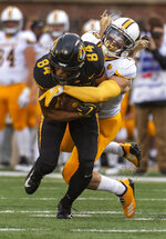 Missouri wide receiver Emanuel Hall, left, pulls down a reception in front of Wyoming safety Andrew Wingard, right, during the first half of an NCAA college football game Saturday, Sept. 8, 2018, in Columbia, Mo. (AP Photo/L.G. Patterson)