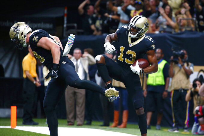 New Orleans Saints wide receiver Michael Thomas (13) celebrates his touchdown reception with tight end Josh Hill in the second half of an NFL football game against the Tampa Bay Buccaneers in New Orleans, Sunday, Oct. 6, 2019. (AP Photo/Butch Dill)