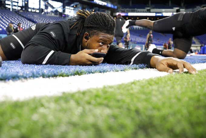 Ohio State defensive lineman Davon Hamilton stretches at the NFL football scouting combine in Indianapolis, Saturday, Feb. 29, 2020. (AP Photo/Charlie Neibergall)