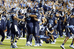North Carolina players celebrate after defeating Duke following an NCAA college football game in Chapel Hill, N.C., Saturday, Oct. 26, 2019. (AP Photo/Gerry Broome)