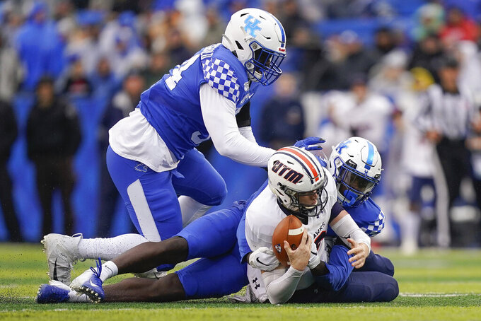Kentucky linebacker Jordan Wright (15) and defensive tackle Abule Abadi-Fitzgerald (94) sack UT Martin quarterback John Bachus III (18) during the first half of an NCAA college football game, Saturday, Nov. 23, 2019, in Lexington, Ky. (AP Photo/Bryan Woolston)