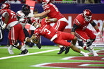 Houston quarterback Clayton Tune (3) avoids a tackles in the end zone against Texas Tech during the first half of an NCAA college football game Saturday, Sept. 4, 2021, in Houston. (AP Photo/Justin Rex)