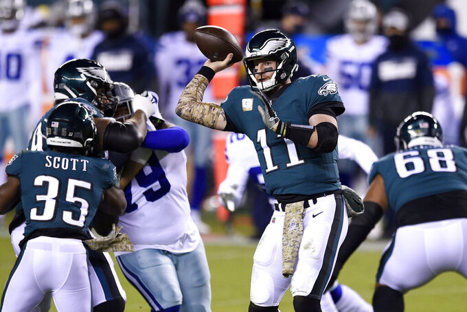 Philadelphia Eagles' Carson Wentz passes during the first half of an NFL football game against the Dallas Cowboys, Sunday, Nov. 1, 2020, in Philadelphia. (AP Photo/Derik Hamilton)