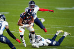 Denver Broncos running back Phillip Lindsay (30) is hit by Tennessee Titans inside linebacker Jayon Brown during the first half of an NFL football game, Monday, Sept. 14, 2020, in Denver. (AP Photo/Jack Dempsey)