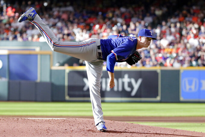 Texas Rangers starting pitcher Kyle Gibson watches a throw to a Houston Astros batter during the first inning of a baseball game Saturday, July 24, 2021, in Houston. (AP Photo/Michael Wyke)