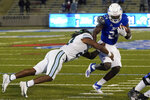 Tulsa running back Corey Taylor II, right, avoids a tackle by Tulane linebacker Dorian Williams during the first overtime of an NCAA college football game in Tulsa, Okla., Thursday, Nov. 19, 2020. (AP Photo/Sue Ogrocki)